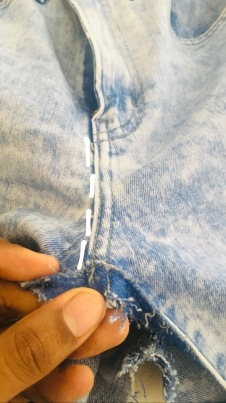 4. Continue to remove the stitches until the zip.