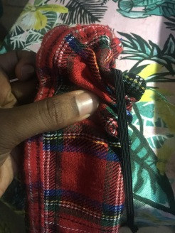 3. Using the pin, turn the fabric inside out.