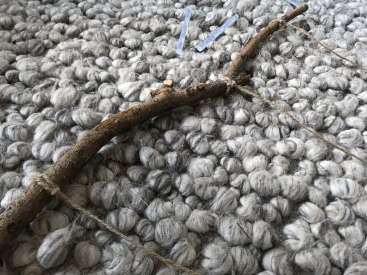 3. Take 3 strips of jute rope and tie it at different spots of the stick. Glue the ends to secure them.