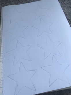 2. Using the star stencil, outline as many stars as required.